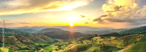 Fotografia, Obraz  Aerial shot of the marvelous teraces rice field in mountains during sunset in Thailand
