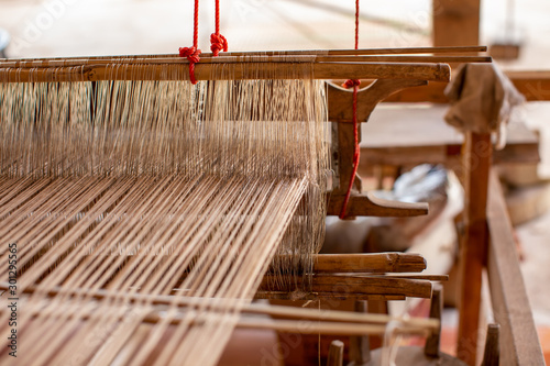 Selective focus of cotton thread on weaver machine Fototapet