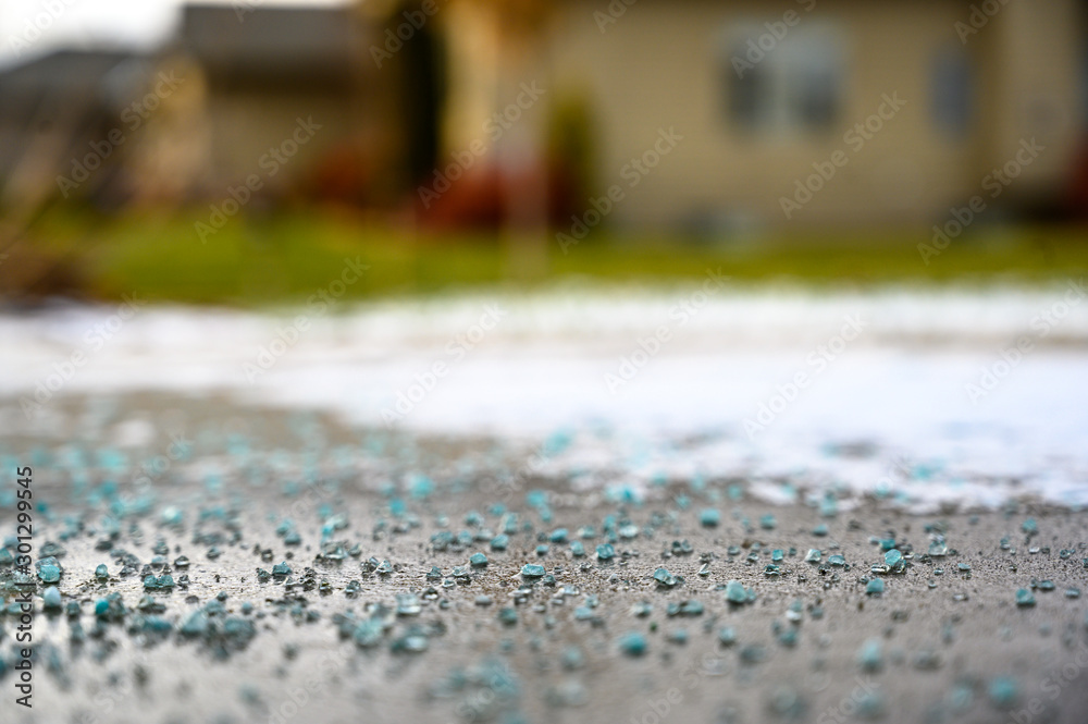 Fototapety, obrazy: Ground level closeup view of rock salt ice-melt  on concrete with snow