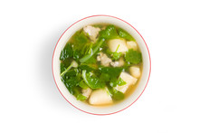 Top View Of Boiled Food With Green Leafy Vegetables, Minced Pork, And Tofu Made From Eggs Placed On White Background. Have A Clipping Path.