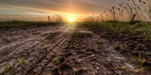 Beautiful Sunset Over A Muddy Field On The Countryside