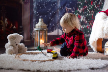 Sweet Toddler Boy,playing With Wooden Train At Home At Night On Christmas