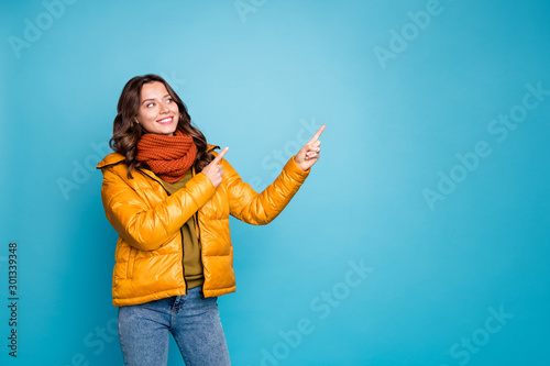 Photo of pretty cute lady indicating fingers empty space showing best shopping p Wallpaper Mural