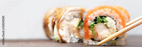 Fotomural Homemade Sushi roll with salmon and cream cheese, banner.