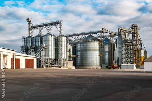 Obraz agro-processing and manufacturing plant for processing and silver silos for drying cleaning and storage of agricultural products, flour, cereals and grain. Granary elevator - fototapety do salonu