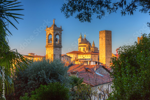 Fototapeta Beautiful towers of the Citta Alta in Bergamo at sunrise, Italy