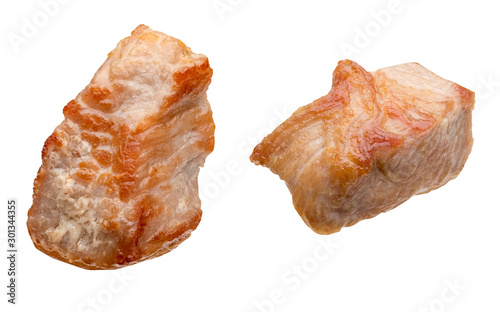 Fototapeta Pieces (in the form of dice) of cooked turkey (chicken) (grilled). Isolated on white background. obraz