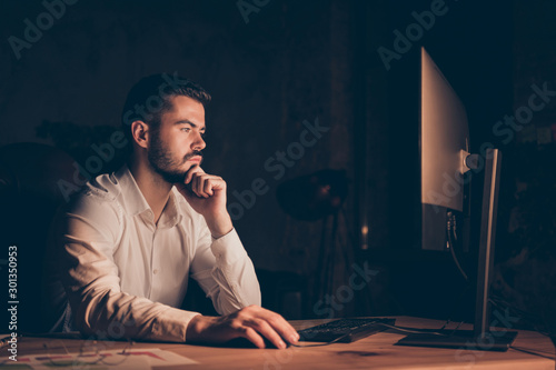 Fotografie, Tablou Photo side profile of serious pensive programmer working overtime interested in