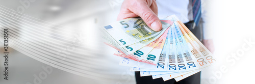 Fotografía Man hand holding euro notes; panoramic banner