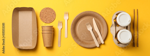 Obraz Flat lay with eco - friendly tableware on yellow background, space for text - fototapety do salonu