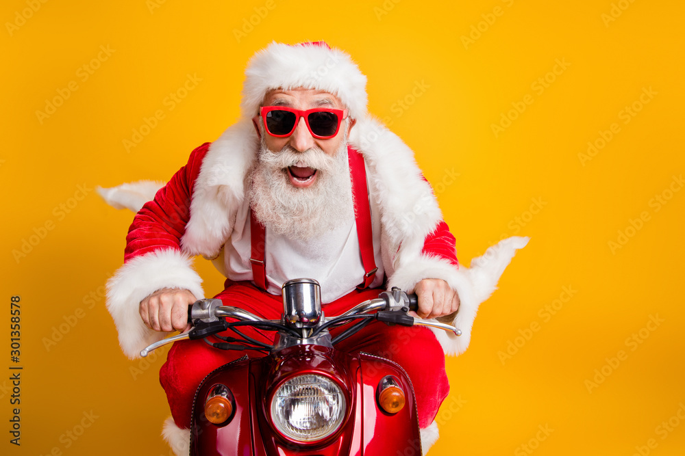Fototapety, obrazy: Fast x-mas traveling. Crazy funky hipster grey haired santa claus in red hat drive scooter hurry scream wear shirt suspenders isolated over bright color background