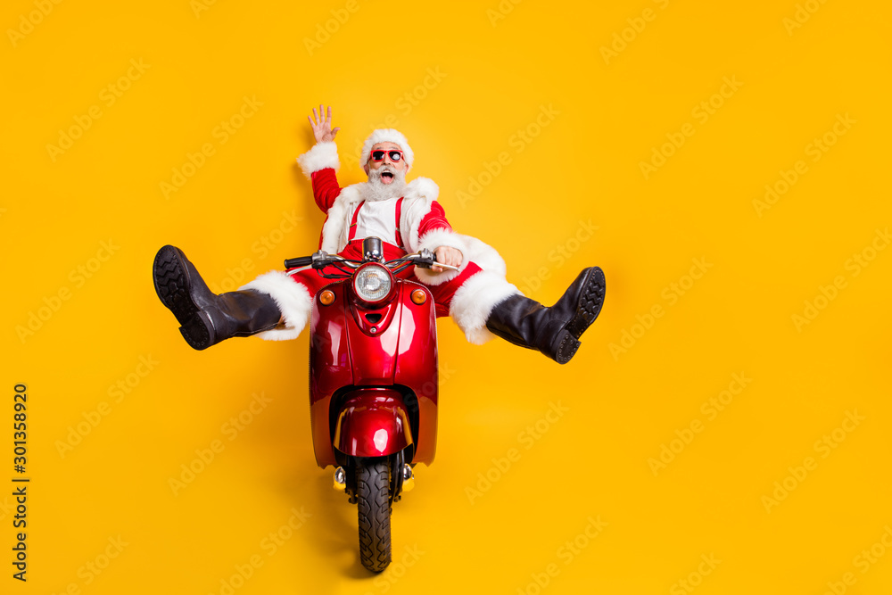 Fototapety, obrazy: Full size photo of amazed funny crazy santa claus in red hat drive fast scooter want hurry on x-mas christmas party shirt suspenders isolated over yellow color background