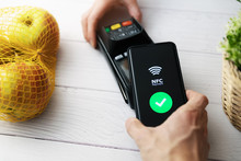 Nfc Contactless Payment With Phone At Groceries Store