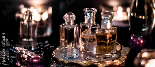 Obraz Perfume bottles and vintage fragrance at night, aroma scent, fragrant cosmetics and eau de toilette as luxury beauty brand, holiday fashion parfum design - fototapety do salonu