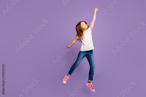Slika na platnu Full body profile photo of funny small ginger lady jumping high rejoicing in air