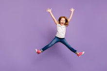 Full Length Photo Of Funny Small Foxy Lady Jumping High Rejoicing Making Star Shape In Air Cheerful Crazy Mood Wear Casual T-shirt Jeans Isolated Purple Background
