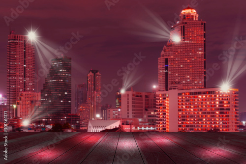 top wood desk with cityscape night lights view blur background,wooden table Wallpaper Mural