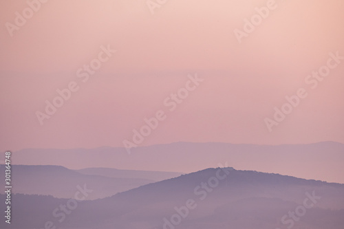 Foto auf Leinwand Rosa hell Minimalistic landscape with mountains in pink colors