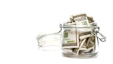 Dollar Bills In Glass Jar On White Background.money Saving Financial Concept.