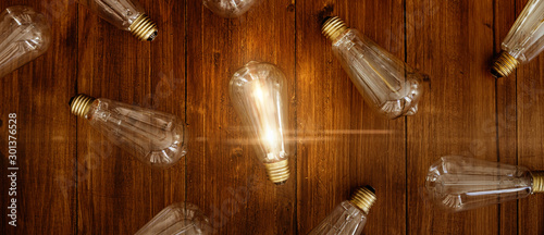 Obraz Glowing bulb. Idea, uniqueness, leadership and difference concept. - fototapety do salonu
