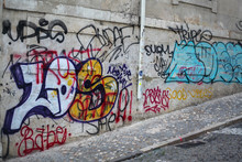 Graffiti Artists Scribble Or Scribble On Walls, Building Facades And Monuments Using Hardly Removable Spray Paint