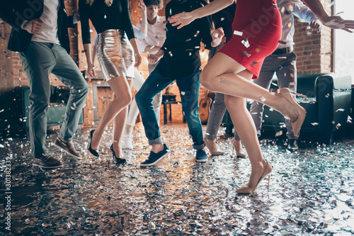 Cropped closeup photo of slim perfect legs girls guys meeting rejoicing dance floor x-mas party glitter flying wear formalwear red dress silver skirt pants restaurant indoors - 301382339