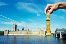 Hand Holding Big Ben Souvenir At The Houses Of Parliament In Westminster, London, UK