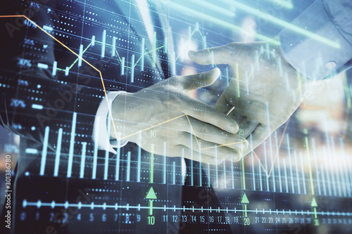 Double exposure of financial chart on cityscape background with two businessmen handshake Wallpaper Mural