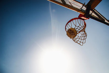 A Basketball Flies Into A Bask...