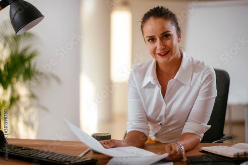 Businesswoman in office Wallpaper Mural