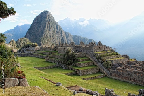 The beautiful ruins of Machu Picchu and in the background Wayna Picchu Wallpaper Mural