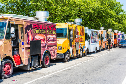 Washington DC, USA - July 3, 2017: Food trucks on street by National Mall with cars driving by on Independence Avenue