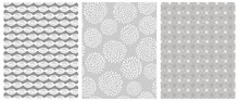 Gray Geometric Seamless Vector Patterns.White Abstract Leaves And Flowers On A Gray Background.Simple Print With White Elements On A Light Gray Layout. Infantile Style Repeatable Vector Design.