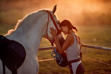Girl love hourse. Woman and her horse on a sunset.