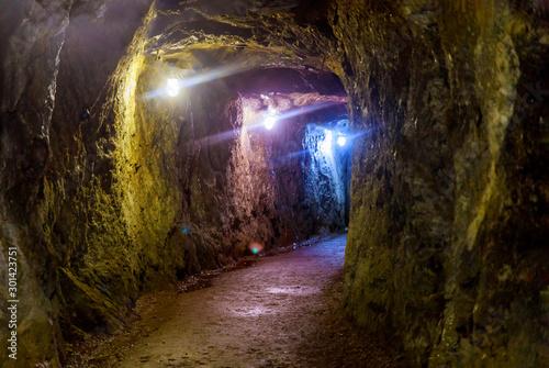 Mining industry underground mine tunnel with lights