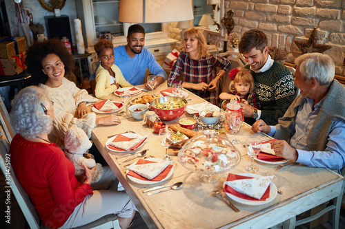 Stampa su Tela Family and friends at  Christmas dinner