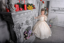Little Girl In Elegant White Victorian Dress In The Interior