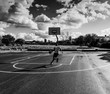 Basketball player driving to the basket in black and white