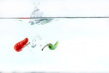 Red Chilli, Water Splashes, Solated On A White Background