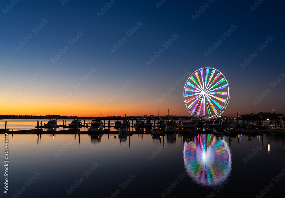 Fototapety, obrazy: Illuminated ferris wheel at National Harbor near the nation capital of Washington DC at sunset