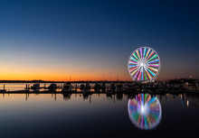 Illuminated Ferris Wheel At National Harbor Near The Nation Capital Of Washington DC At Sunset