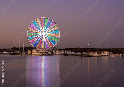 Fototapeta Illuminated ferris wheel at National Harbor near the nation capital of Washington DC at sunset obraz