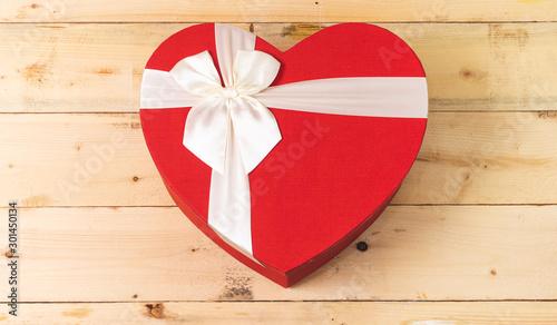 Fototapeta closed heart shaped box on wood table  obraz