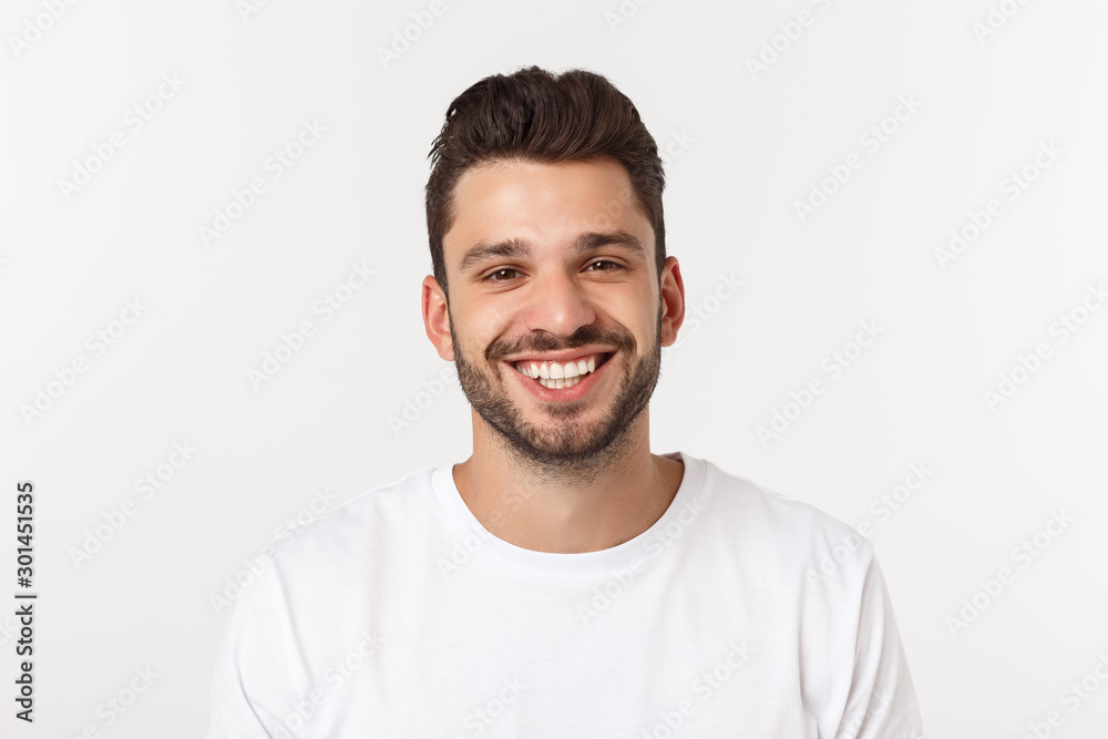 Fototapeta Portrait of a handsome young man smiling against yellow background