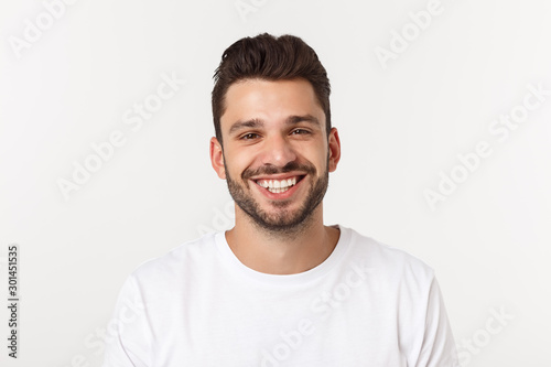 Fototapeta Portrait of a handsome young man smiling against yellow background obraz