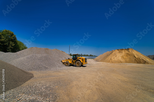 Quarry aggregate with heavy duty machinery Wallpaper Mural