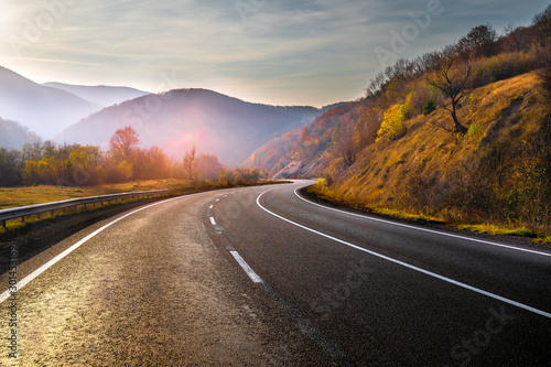 Obraz na płótnie Highway in mountains in autumn evening