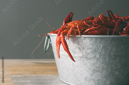 Canvastavla Crawfish boil in a steel bucket against a gray background with copy space