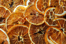 Dried Orange On A Wooden Table In The Kitchen