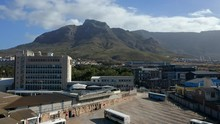 Revealing Shot Of The Cape Town City, Road, And Mountainscape